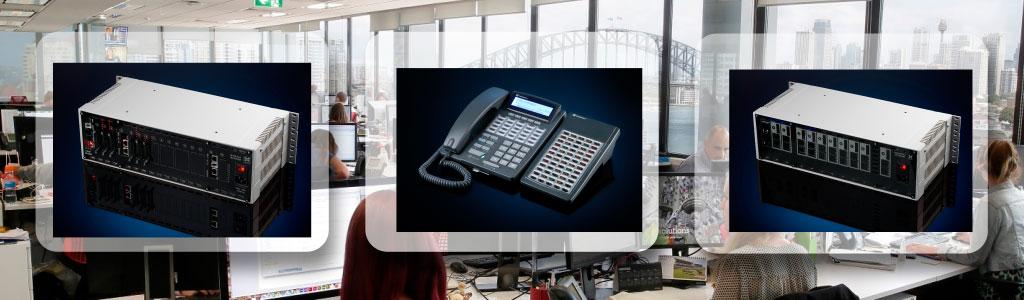 Мини АТС и системный телефон на фоне офисного интерьера